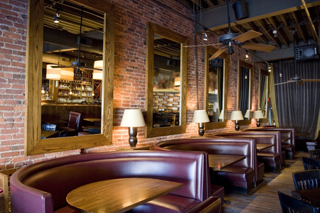 Classy Restaurant Bar with Booths, Mirrors and Red Brick Walls
